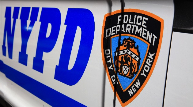 NYPD (New York Police Department) Sign with Logo on Police Patrol Car in New York City. USA